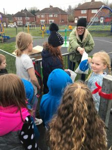 children gathering for park opening