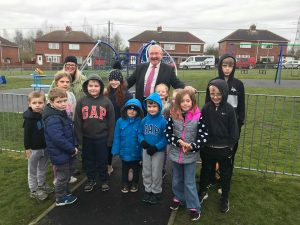 children and man gather for park opening